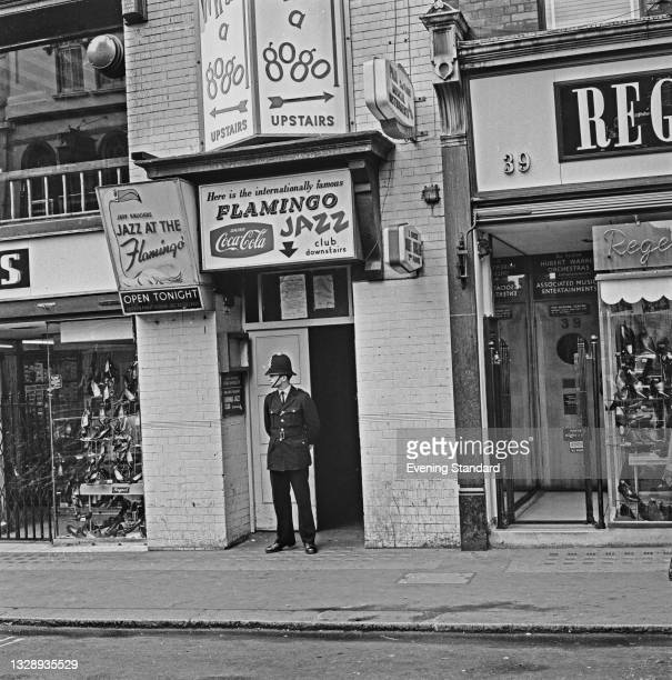 Policeman guards the entrance to the Whisky A Gogo nightclub and the Flamingo Jazz Club at 37 Wardour Street in London's Soho district, after Lionel...
