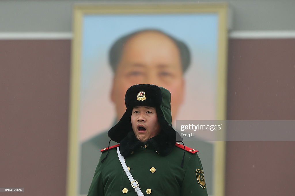 A policeman guards with uncomfortable expression in front of a giant portrait of the late chairman Mao Zedong at the Tiananmen Square during severe pollution on January 31, 2013 in Beijing, China. Heavy smog that has choked Beijing for the last five days weakened slightly on Thursday due to a light rainfall, although the capital's air remains heavily polluted. The haze choking many Chinese cities covers a total area of 1.43 million square kilometers, the China's Ministry of Environmental Protection said Wednesday.