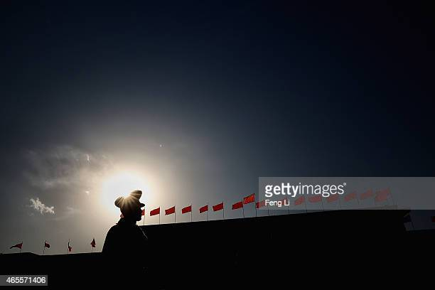 A policeman guides outside the Great Hall of the People during the second plenary session of China's parliament the National People's Congress on...