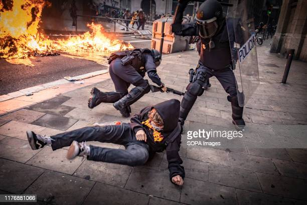 Policeman hits a protester during the demonstration. Fifth day of protest after the announcement of the sentences by the Supreme Court of Spain that...