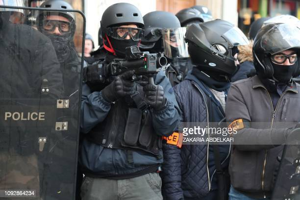 Policeman holds a 40-millimetre rubber defensive bullet launcher LBD with an attached camera during clashes with protesters on February 2, 2019 in...