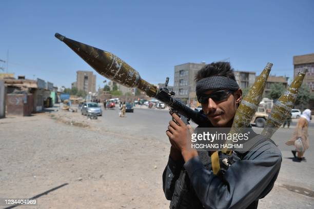 Policeman holds a rocket-propelled grenade along a road in Herat on August 2, 2021.