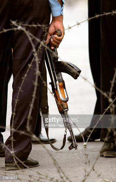 A policeman holds an AK47 while guarding a roadblock outside the Presidential Palace November 4 2007 in Islamabad Pakistan Pakistani President Pervez...