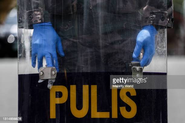 Policeman holds his riot shield as members of an LGBT group protest against the early release of US soldier Joseph Scott Pemberton. President Rodrigo...