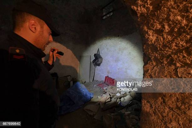 Policeman in a hidden room, with different objects during a operation of the police, to the underground Naples city, in search of the fugitive mafia,...