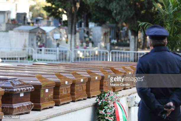 A policeman in front of the coffin during the funeral of the 28 migrant women who died in a shipwreck as they sought to reach Italy