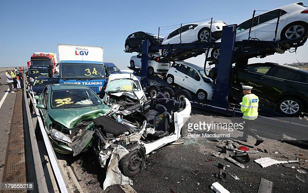 A policeman inspects the site of a major traffic accident on the A249 Sheppey crossing bridge in Kent on September 5 2013 in Isle of Sheppey Kent...