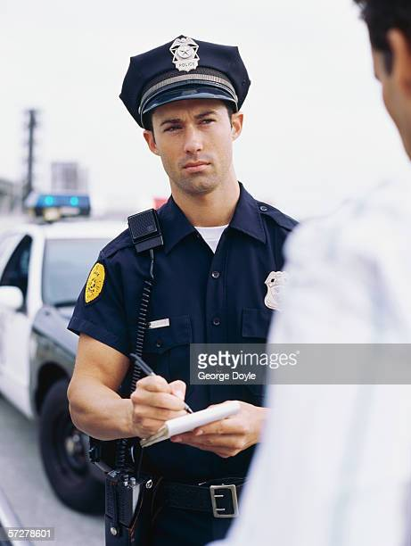 Policeman interrogating and taking notes