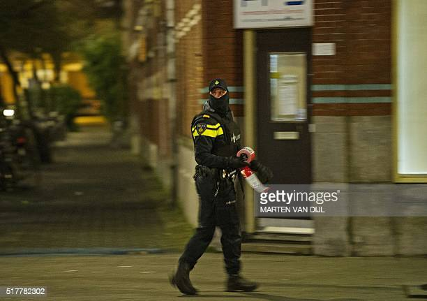 A policeman is at work near the place where a 32yearold Frenchman was arrested at the request of French authorities over suspicsions of his...