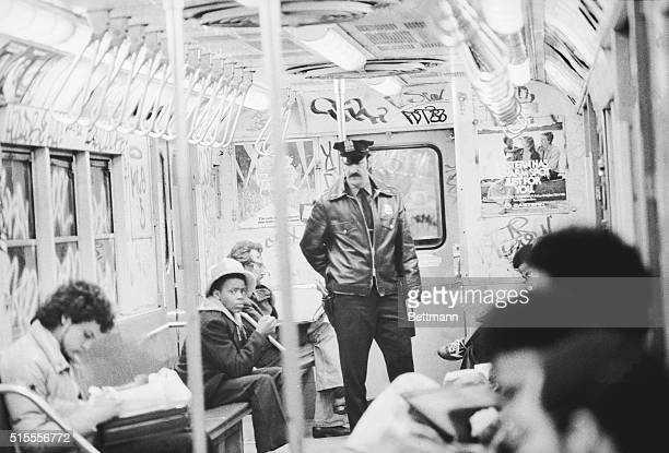 A policeman is on duty on a New York City subway train late March 19 as a new campaign to combat subway crime begins A force of 900 uniformed police...