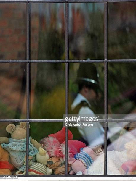 A policeman is reflected in the window of the home of Gerry and Kate McCann as they arrive back in the UK on September 9 2007 in Rothley England The...