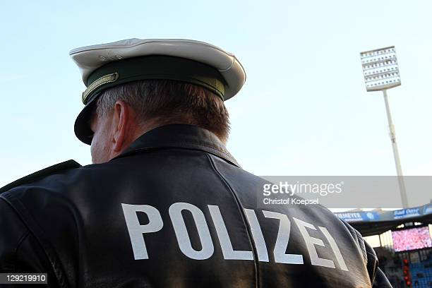 A policeman is seen in the stadium after a bomb threating prior to the Second Bundesliga match between VfL Bochum and Eintracht Frankfurt at...