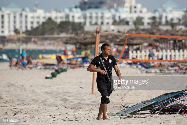 A policeman is seen patrolling the beach ahead of a memorial service for the victims of the 2015 Sousse Beach terrorist attack on June 26 2016 in...