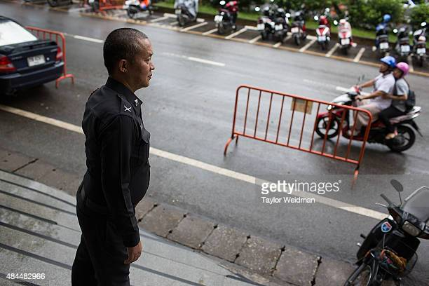 A policeman is stationed in the area around Wat Doi Suthep a popular temple among both locals and tourists on August 19 2015 in Chiang Mai Thailand...