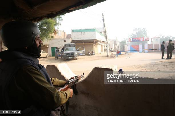 A policeman keeps watch outside the central jail as the court delivered the verdict on a blasphemy case in Multan on December 21 2019 A Pakistani...