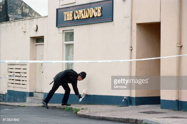 Policeman laying flowers outside The Coxlodge in Fawdon Newcastle upon Tyne where last night Derek Lee was murdered by Steven Cook and John Harvey...
