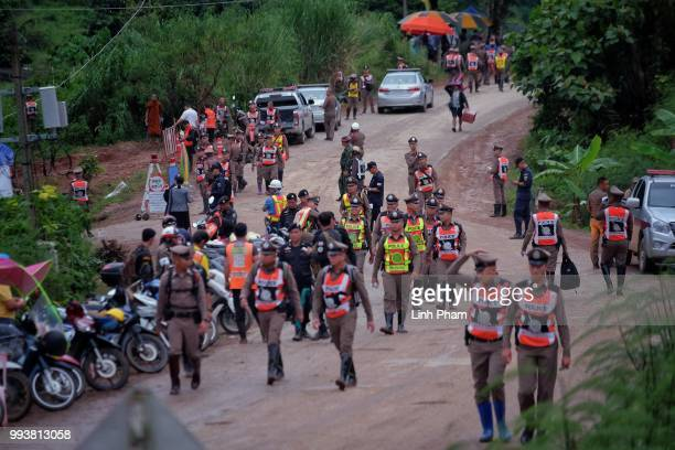 Policeman line up on the main road leading to Tham Luang Nang Non cave on July 8 2018 in Chiang Rai Thailand Divers began an effort to pull the 12...