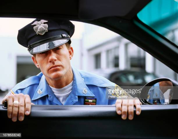 usa policeman looking into car window - traffic examining stock pictures, royalty-free photos & images