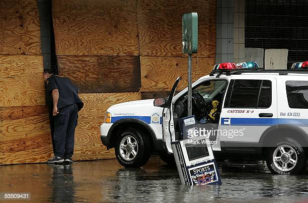 Policeman looks inside a building on Canal Street after Hurricane Katrina hit the area August 29, 2005 in New Orleans, Louisiana. Katrina was down...