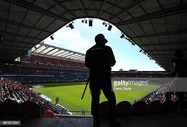 A policeman looks on prior to the start of the La Liga match between CA Osasuna and Real Betis Balompie at Estadio Reyno de Navarra on May 18 2014 in...