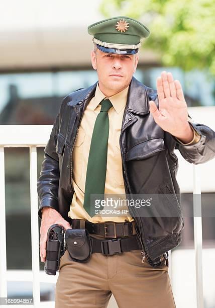 Policeman making stop gesture