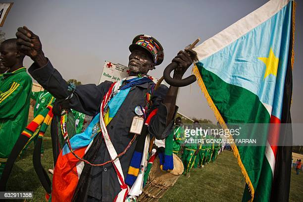 A policeman marches with the South Sudanese flag on January 28 during the opening ceremony of the second National Unity Day at the Juba National...