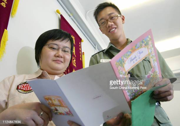Policeman Mok Winglun of Tuen Mun Police Station receives a thankyou card from Ivy Wong Limyan the granddaughter of an 78yearold elderly for rescuing...