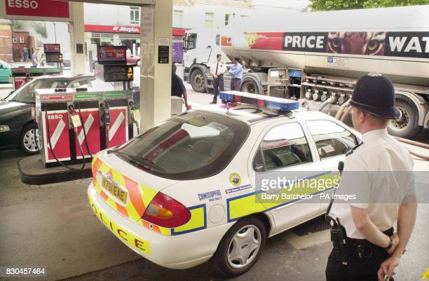 A policeman monitors a delivery of fuel to an Esso garage in Gloucester Road in Horfield Bristol The tanker had earlier left Avonmouth Docks