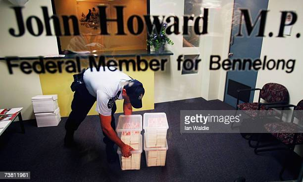 A policeman moves boxes containing a petition in support of David Hicks after it was delivered to the office of Australian Prime Minister John Howard...