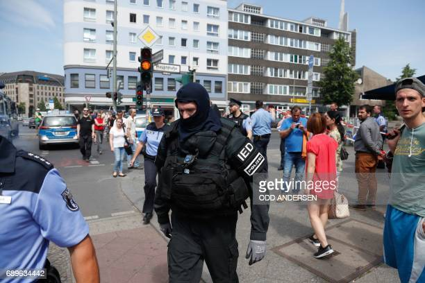 A policeman of a special unit wears protective clothing as he walks through Berlin's Schoeneberg district where a man was arrested after a suspicious...
