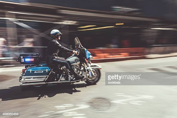 Policeman on Motorbike Speeding in New York, NYPD