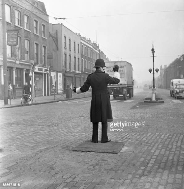 A policeman on point duty at the junction of Commercial Road with the junction of East India Dock Road and West India Dock Road stands on a mat 11th...