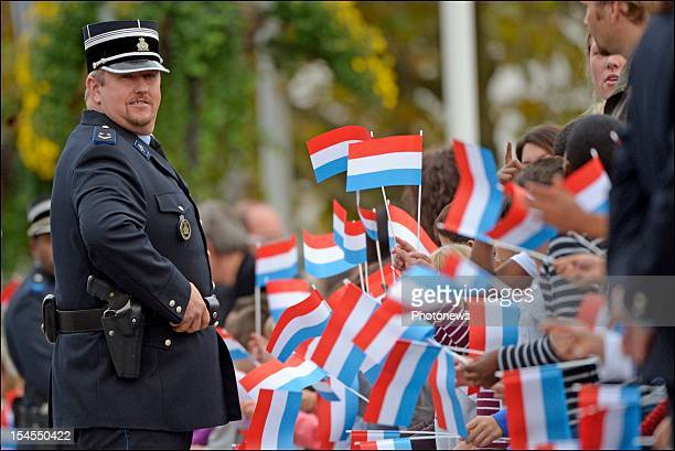 Policeman on the street during the civil wedding ceremony of Prince Guillaume Of Luxembourg and Countess Stephanie de Lannoy at the Hotel De Ville on...