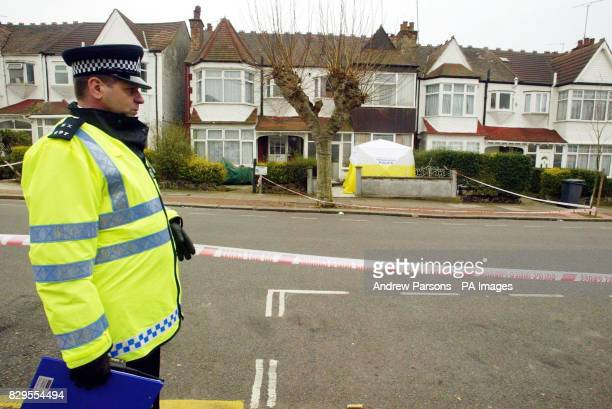 A policeman outside the home of Anne Mendel who died following a violent raid on her property in Elmcroft Crescent