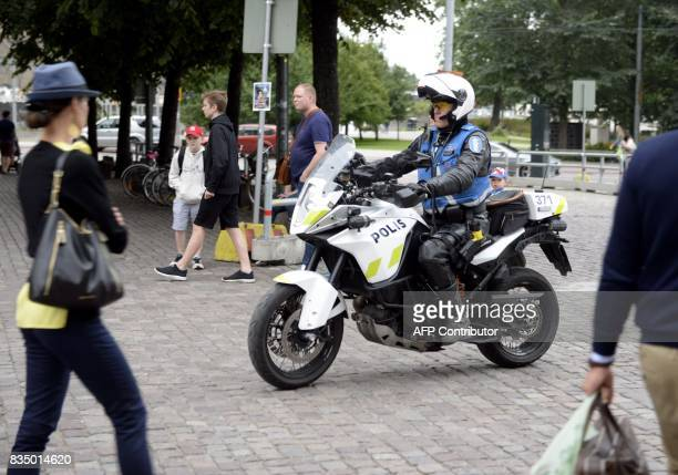 A policeman patrols in Central Helsinki on August 18 2017 Finnish Police announced they will rise the readiness after stabbings in Turku / AFP PHOTO...
