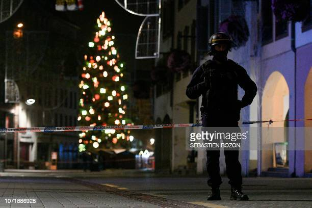 A policeman patrols in the rue des Grandes Arcades in Strasbourg eastern France after a shooting breakout on December 11 2018 A gunman killed at...