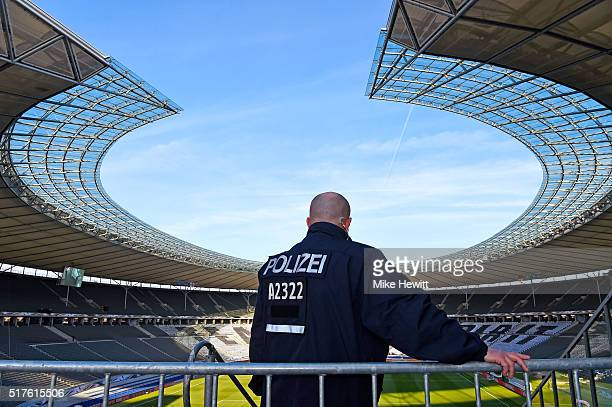 A policeman patrols inside the ground prior to the International Friendly match between Germany and England at Olympiastadion on March 26 2016 in...