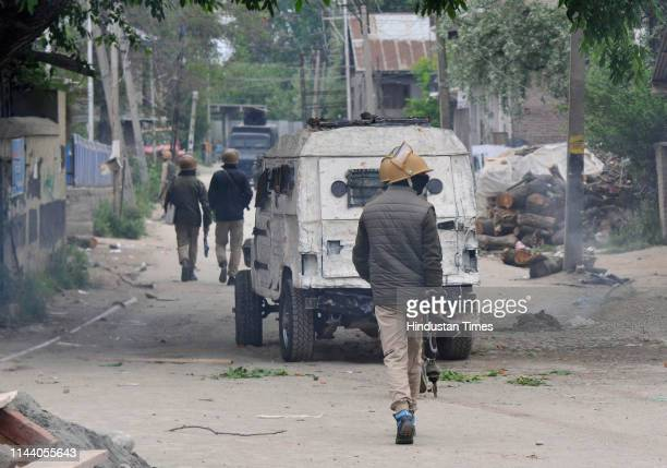 A policeman patrols near the site of the encounter at Dalipora on May 16 2019 in Pulwama India Three militants an army man and a civilian were killed...