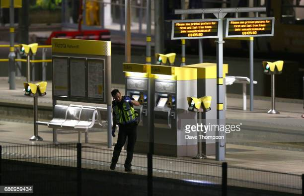 A policeman patrols Victoria Railway Station close to the Manchester Arena on May 23 2017 in Manchester England An explosion occurred at Manchester...
