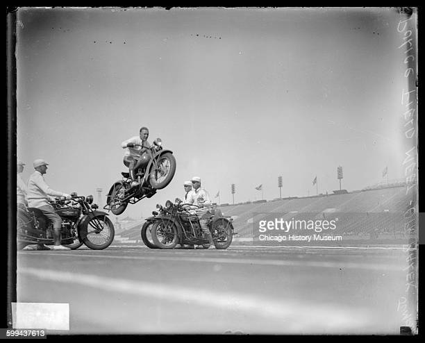 Policeman performing a motorcycle jump during a police meet at Soldier Field located at 1600 South Lake Shore Drive Chicago Illinois 1929