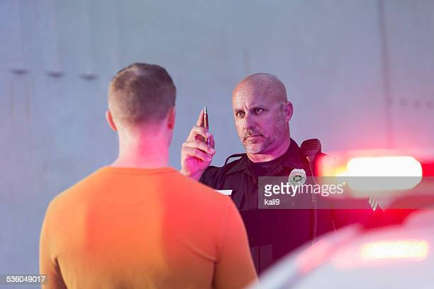 policeman performing sobriety test on driver - criminal stock pictures, royalty-free photos & images