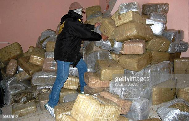A policeman piles packages of confiscated marijuana in Nuevo Laredo Tamaulipas state Mexico in the border with the United States on January 8 2010...