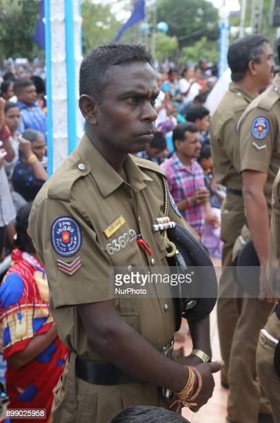 Policeman praying at the Shrine of Our Lady of Madhu during the Feast of Our Lady of Madhu in Mannar Sri Lanka With a history of over 400 years this...