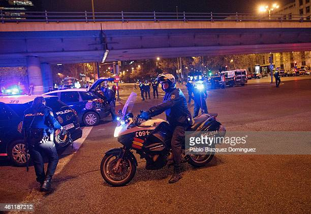 A policeman prepares to leave on his motorbike after a suspicious package which was thought to be a bomb was found not to be dangerous at Nuevos...