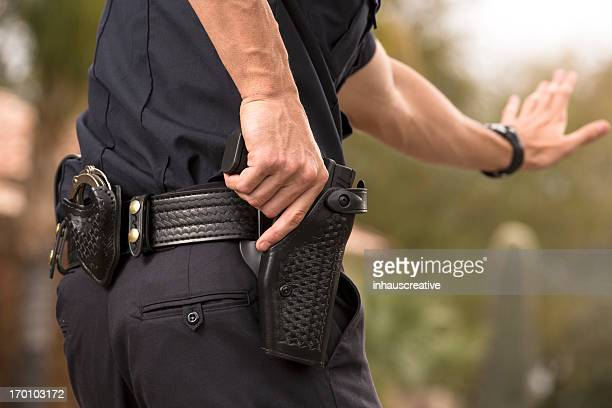 policeman preparing to draw his gun - weapon stock pictures, royalty-free photos & images