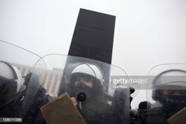 Policeman protect Smolensk Memorial during We Are Going For Freedom We Are Going For Everything protest organized by Womens Strike and Anti Lockdown...