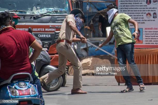 Policeman punish people who break lockdown rules at Bhandup on April 4 2020 in Mumbai India