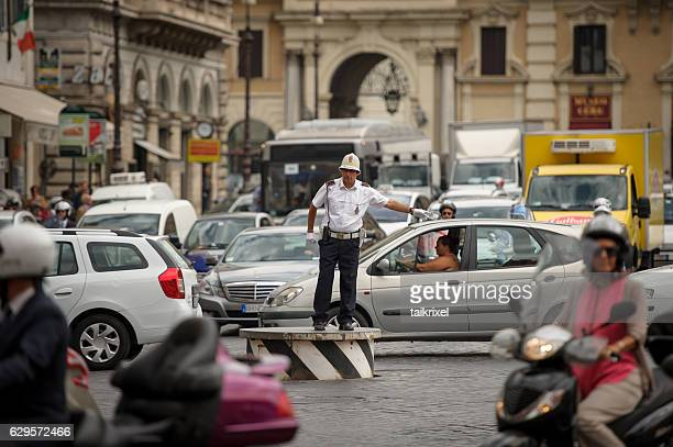 policeman regulates traffic, rome - traffico foto e immagini stock