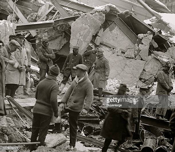 Policeman rescue workers and onlookers stand amid the wreckage of the Knickerbocker Theatre Washington DC January 29 1922 The structure's roof...