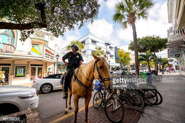 Policeman riding horse on Duval street, Key West, USA